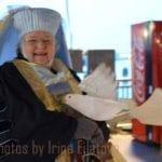 Krewe member Judy wearing a fillet hat and veil